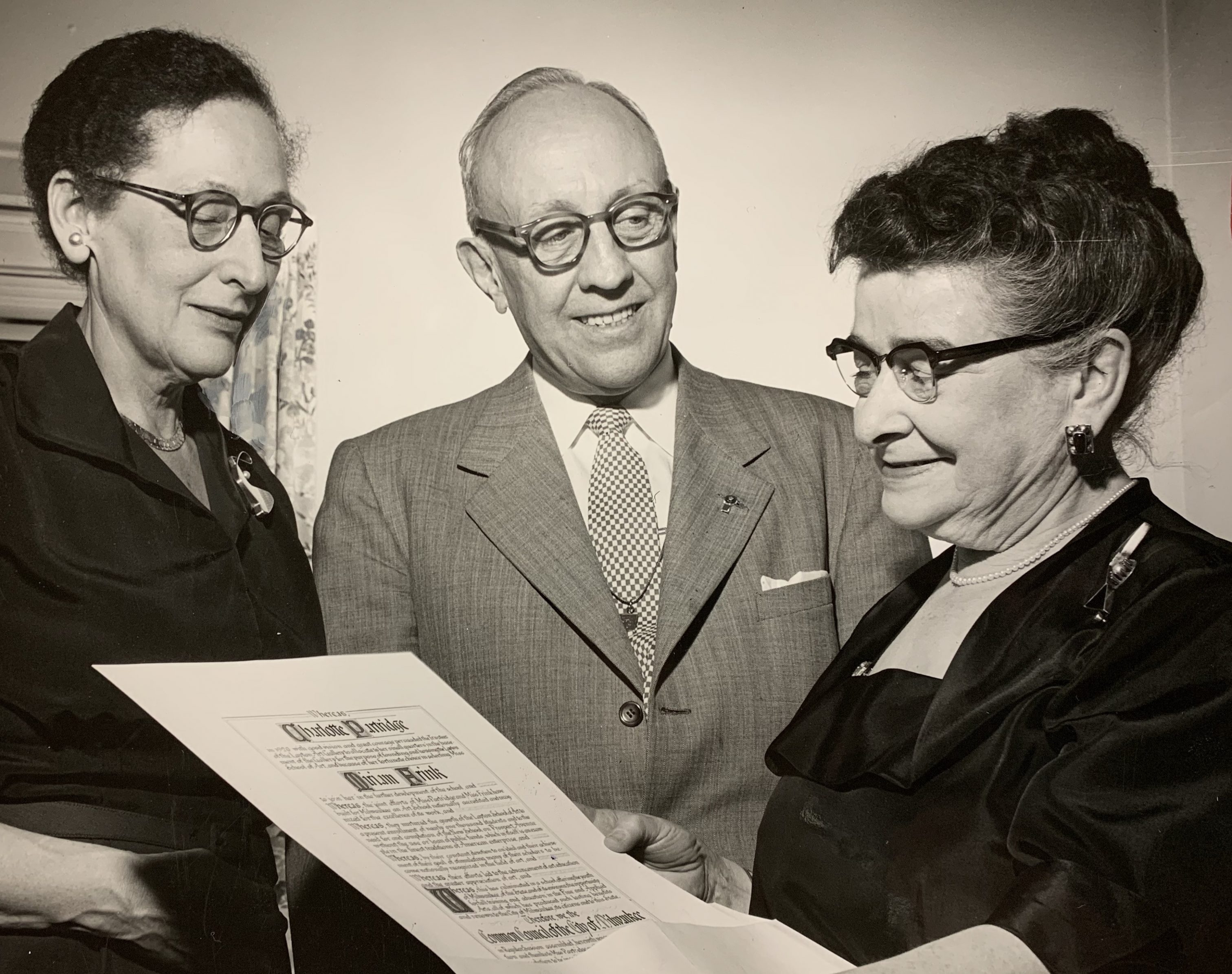 "To honor their ""unusual foresight and great courage,"" Miriam Frink (left) and Charlotte Partridge (right) were presented with illuminated scrolls at the Layton School of Art's 34th commencement in 1954."