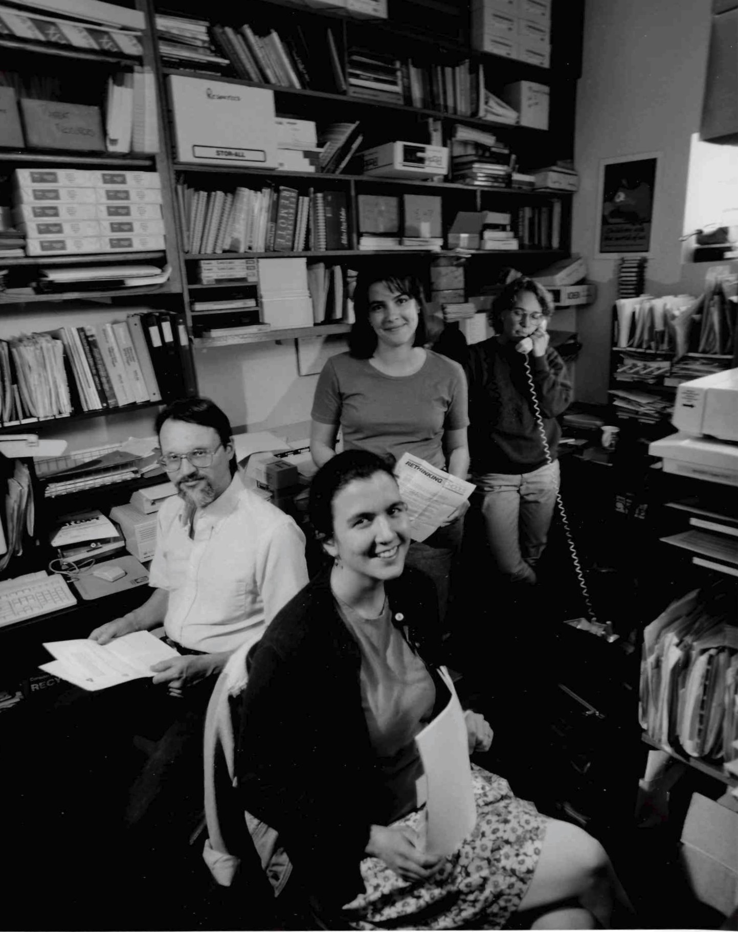 In its early years, Rethinking Schools was headquartered in a small office of the Milwaukee Peace Action Center. Pictured from the foreground to background are Jennifer Morales, Mike Trokan, Sharon Matthias, and Barbara Miner.