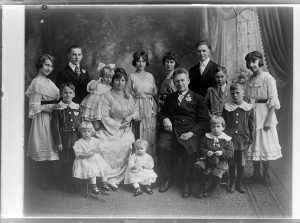 This iconic family portrait, taken during the early 20th century in Milwaukee's Polonia neighborhood, features the Uszler family and their 13 children.