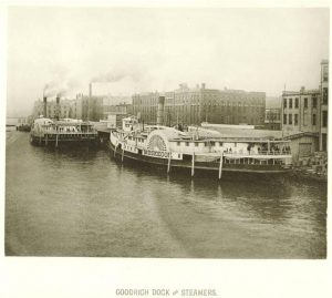 Two wooden steamboats sit in their docks on the Milwaukee River in 1885.