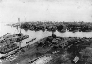 The Wolf and Davidson shipyard is visible in the foreground of this 1912 photograph while the settlements on Jones Island can be seen in the background.