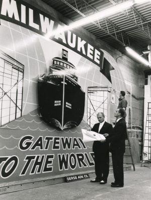 "This large sign, which reads ""Milwaukee - Gateway to the World,"" hung from the Lincoln Memorial Bridge to celebrate the opening of the St. Lawrence Seaway."