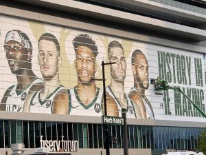 """A work crew at the Fiserv Forum updating the """"History in the Making Sign"""" the morning after the Milwaukee Bucks won the 2021 National Basketball Association championship for the first time in 50 years."""